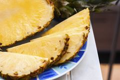 Fresh ripe pineapple slices on the plate royalty free stock photography
