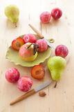 Fresh ripe plums, apples and pears Stock Image