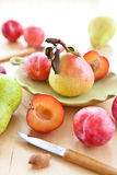 Fresh ripe plums, apples and pears Royalty Free Stock Image