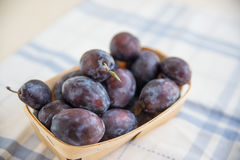 Fresh ripe plums. In a bowl Stock Photo