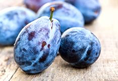 Fresh ripe plums on a wooden background Stock Photography