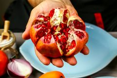 Fresh ripe pomegranate. fruit with seeds in hand. top view. free space for text