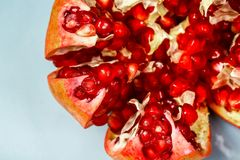 Fresh ripe pomegranate. fruit with seeds on light background. top view. free space for text