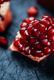 Fresh ripe pomegranate on a slate plate kitchen table.  Royalty Free Stock Images