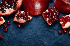 Fresh ripe pomegranate on a slate plate kitchen table.  Royalty Free Stock Photos