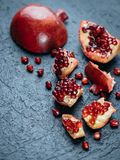 Fresh ripe pomegranate on a slate plate kitchen table.  Royalty Free Stock Image