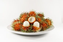 Fresh ripe rambutan on dish with white background. Thai fruit Royalty Free Stock Photography