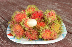 Fresh ripe rambutan fruit. Yummy fresh ripe rambutan fruit in the plate Stock Images
