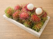 Fresh Ripe Rambutan on Wooden Serving Plate Royalty Free Stock Photos
