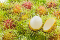 Fresh and ripe rambutans. Delicious fruits for asian Stock Photography
