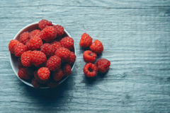 Fresh ripe raspberries in a bowl Royalty Free Stock Photos