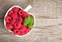 Fresh ripe raspberries bowl Stock Photo