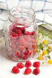 Fresh ripe raspberries and camomile flowers Royalty Free Stock Photography