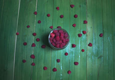 Fresh ripe raspberries on green wooden boards. Royalty Free Stock Photography