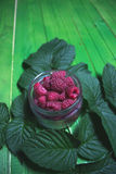 Fresh ripe raspberries on green wooden boards. Royalty Free Stock Photos