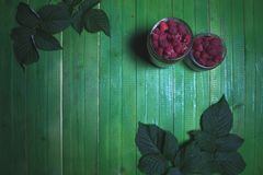 Fresh ripe raspberries on green wooden boards. Royalty Free Stock Images