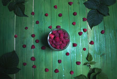 Fresh ripe raspberries on green wooden boards. Stock Images