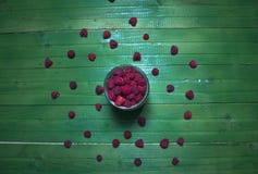Fresh ripe raspberries on green wooden boards. Stock Image