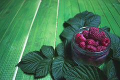 Fresh ripe raspberries on green wooden boards. Stock Photography