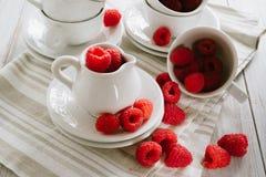 Fresh ripe raspberries. Fresh ripe red raspberries on white plates Royalty Free Stock Photos