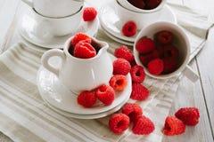 Fresh ripe raspberries. Fresh ripe red raspberries on white plates Stock Image