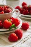 Fresh ripe raspberries. Fresh ripe red raspberries on white plates Stock Photography