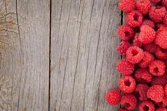 Fresh ripe raspberries on wooden table. Background with copy space Royalty Free Stock Images