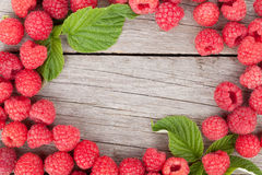 Fresh ripe raspberries on wooden table. Background with copy space Royalty Free Stock Photography