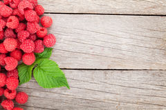 Fresh ripe raspberries on wooden table. Background with copy space Stock Photos