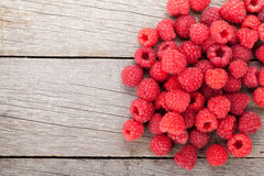 Fresh ripe raspberries on wooden table. Background with copy space Stock Photography