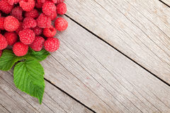 Fresh ripe raspberries on wooden table. Background with copy space Royalty Free Stock Photos