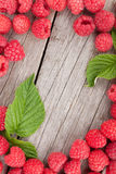Fresh ripe raspberries on wooden table. Background with copy space Royalty Free Stock Image