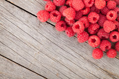 Fresh ripe raspberries on wooden table. Background with copy space Royalty Free Stock Photo