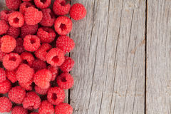 Fresh ripe raspberries on wooden table. Background with copy space Stock Images