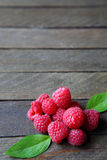 Fresh and ripe raspberries on a wooden table Stock Photo