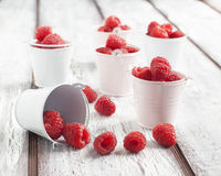 Fresh ripe raspberry in small bucket. On wooden table Stock Photos