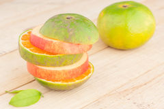 Fresh Ripe Red Apple And Green Orange On Wooden Table. Stock Image
