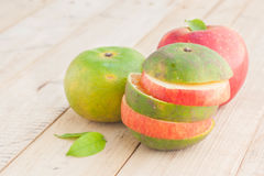 Fresh Ripe Red Apple And Green Orange On Wooden Table. Royalty Free Stock Photos