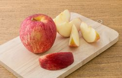 Fresh Ripe Red Apple on Wooden Tray Stock Photo