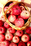 Fresh ripe red apples in basket on the table Stock Photo