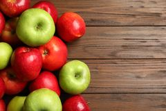 Fresh ripe red apples. On wooden background royalty free stock photos