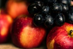 Fresh ripe red apples and grapes close Stock Photo