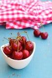 Fresh ripe red cherries. Fresh ripe organic red cherries on blue background Royalty Free Stock Photos