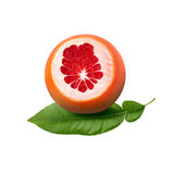 Fresh ripe red grapefruit with green leaves. Red sliced citrus isolated. Royalty Free Stock Photography