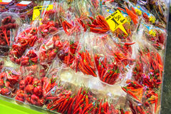 Fresh ripe red habanero and chili pepper in plastic bags Royalty Free Stock Photography
