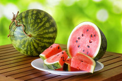 Fresh ripe red juicy watermelon on a wooden table Royalty Free Stock Photo