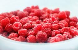 Fresh ripe red pretty raspberry. Fresh red ripe pretty raspberies in light plate for pleasure Royalty Free Stock Photo