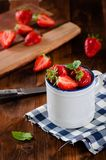 Fresh ripe red strawberries in white enamel cup Stock Photography