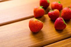 Fresh ripe red strawberries on wooden table Royalty Free Stock Images
