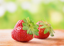 Fresh ripe red sweet strawberries on wooden board Royalty Free Stock Image